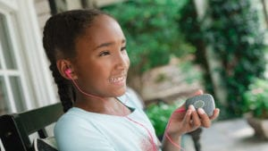 girl listening to music on her Relay