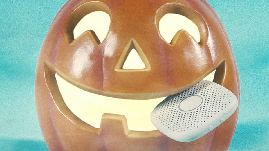 smiling jack-o-lantern with a Relay kids phone